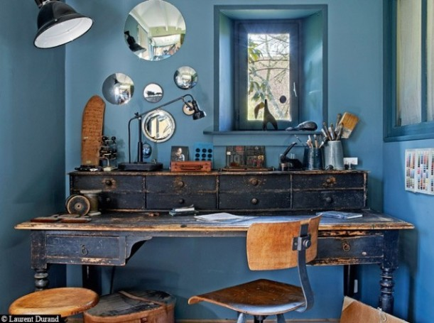 Recycled furniture and trashed bits bring memorable character to this office space.
